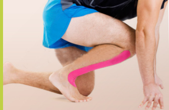 Sport injuries. man in  sprint start position with strap on shin
