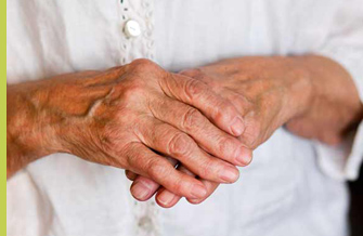 old wrinkly hands clutching each other
