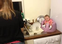 young baby in moulded seat, childhood development    mammaot.com